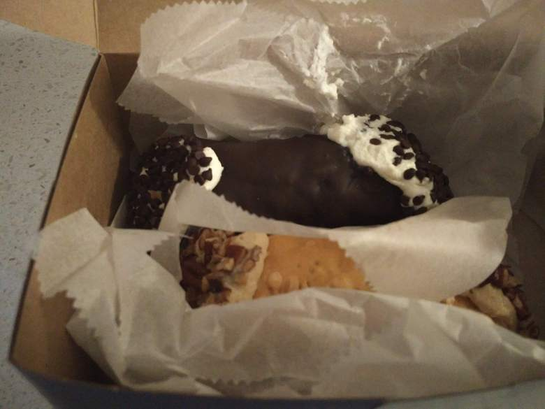 Chocolate-covered and Pecan Caramel cannolis from Mike's Pastry